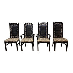 "Greek Key Fretwork Black Dining Chairs - Set of 4 - A set of 4 Chinoiserie inspired fretwork dining chairs, circa 1970s. They are freshly refinished in a high gloss, durable black enamel with fine quality grey and creamy ivory ikat upholstery.  The intricate fretwork features a Greek key design that also presents itself at the top of the chair and just below the seat. The chair has faux caning in the center of the back rest. We love all the gorgeous details of these chairs, including the brass feet. This set of 4 includes 2 captain's chairs. The chairs are in excellent condition. The chair frames are constructed of sturdy wood; the fretwork is a sturdy composite. A few areas exist where the fretwork has separated from the connecting piece. Due to the intricate nature of the fretwork, this is very difficult to notice.  This does not affect the structure or function of the chair at all.  Please see photo. The seat cushion measures 20""W at the widest point by 16 3/4"" D.  The captain's chairs measure 23.5""W at the widest point."