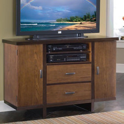 """Home Styles - Homestead 44"""" Geo TV Stand - With a sophisticated, Art Deco inspired design, the Geo compact TV credenza combines style with function in a compact design to fit rooms with limited space. The 44'' wide top is ideal for today's flat screened TVs and there is plenty of space for electronic storage. First, there is a cable accessible open compartment with an adjustable/removable shelf. Below that there are two, cable accessible drawers with drop-fronts that can also be used to house electronics or can be used as standard drawers. Drawers are suspended on metal drawer glides. For DVD and other media storage there are two cabinets, each with two adjustable shelves. Construction is of poplar hardwood solids and walnut veneers with a multi-step walnut finish including a clear coat finish to help protect against wear and tear from normal use. Features: -Compact design.-Art Deco inspired design, combines style with function in a compact design to fit rooms with limited space.-Ideal for today's flat screened TVs.-The frame and top edges feature contrasting dark walnut veneer trim.-Features two full depth side compartments - doors swing out to reveal generous storage space for CD's and DVD's.-Center features open storage space with shelf and two large easy glide storage drawers.-Fronts drop down for easy access to game equipment.-There are two cable accessible drawers.-Accommodates most 47'' TV's.-Hardwoods and veneer construction.-Walnut finish.-Antique brass finish hardware.-Recommended TV Type: Up to a 42"""" flat panel TV.-Finish: Nutmeg.-Powder Coated Finish: No.-Gloss Finish: No.-Material: Poplar solids and walnut veneers.-Distressed: No.-Exterior Shelves: Yes -Number of Exterior Shelves: 1.-Adjustable Exterior Shelves: Yes..-Drawers: Yes -Number of Drawers: 2.-Drawer Interior Finish: Same as exterior.-Drawer Glide Material: Metal.-Drawer Glide Extension: 0.75.-Safety Stop: Yes.-Ball Bearing Glides: No.-Drawer Dividers: No.-Drawer Handle Design: Linear pulls..-"""