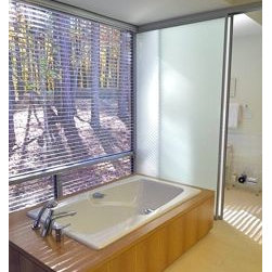 Sliding Glass Partitions - Want lots of light, but divided space?  Glass partition with a satin finish does the job well.