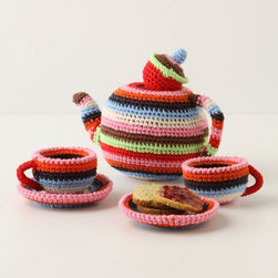 """Make-Believe Tea Set - This soft tea set is a perfect touch to your Wonderland-themed or whimsical English tea themed nursery. Plus pretend tea is sweetest, or at least the most joyful, from this delightful crocheted set.Set of plush teapot and two cups and saucersPolypropylene; cotton fillSpot cleanTeapot: 5""""H, 6.5"""" diameterCups & Saucers: 2.5""""H, 3"""" diameterImported"""