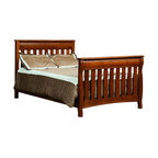 Chelsea Home Furniture - Chelsea Home Cambridge Crib with Full Size Rails in Asbury Brown Stain - As children go through stages as they grow, so should their furniture. The Cambridge Convertible Crib Set, shown in White Quartersawn Oak and Asbury Brown stain, is a solid wood 3-stage bed system that is constructed with quality and durability to transition any newborn into adulthood with simplistic sophistication. The curved slats and feet compliment the stream line sides of crib. This CPSC 16 CFR 1219 and 1220 compliant convertible piece is complete with guard rail and 3-level mattress support, and simple transition instructions to keep your child resting easy and comfortable. Chelsea Home Furniture proudly offers handcrafted American made heirloom quality furniture, custom made for you. What makes heirloom quality furniture? It's knowing how to turn a house into a home. It's clean lines, ingenuity and impeccable construction derived from solid woods, not veneers or printed finishes over composites or wood products _ the best nature has to offer. It's creating memories. It's ensuring the furniture you buy today will still be the same 100 years from now! Every piece of furniture in our collection is built by expert furniture artisans with a standard of superiority that is unmatched by mass-produced composite materials imported from Asia or produced domestically. This rare standard is evident through our use of the finest materials available, such as locally grown hardwoods of many varieties, and pine, which make our products durable and long lasting. Many pieces are signed by the craftsman that produces them, as these artisans are proud of the work they do! These American made pieces are built with mastery, using mortise-and-tenon joints that have been used by woodworkers for thousands of years. In addition, our craftsmen use tongue-in-groove construction, and screws instead of nails during assembly and dovetailing _both painstaking techniques that are hard to come by