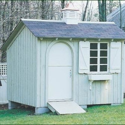 8' x 10' Board and Batten Building - A Walpole Brittany Cupola sits atop a building that features an arched Dutch door and ramp.