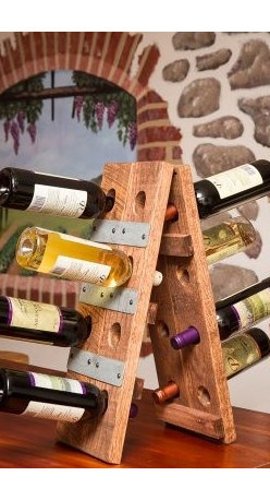 Napa East Wine Barrel Small Folding 16 Bottle Riddling Wine Rack - Convenient, unobtrusive and visually appealing, the Napa East Wine Barrel Small Folding 16 Bottle Riddling Wine Rack is an ideal wine rack for those special bottles in your collection. Perfect for bar-top placement, this solid wood rack made from a reclaimed oak wine barrel holds up to 16 bottles.About Napa EastNapa East creates wine-inspired furnishings that are made from actual reclaimed oak wine barrels. Their barrels began life handcrafted with pride from the finest French and American Oaks, and Napa East continues that theme when they hand-select barrels and giving them new life as beautiful one-of-a-kind works of art.