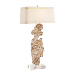 Provence Painted Hand Carved Solid Wood Fragment / Acrylic Lamp - Delicate florets fluttering in a midsummer breeze are captured in the exquisite carved details of the Provence Hand Painted Carved Solid Wood Fragment/Acrylic Lamp. A leaf and bloom design, touched with dainty wisps of glistening gold,  forms the base. Completing the impressive light is a refined rectangular shade of linen framed with a Gold Silk Ribbon Accent that is harmonious with the gold embellished base.
