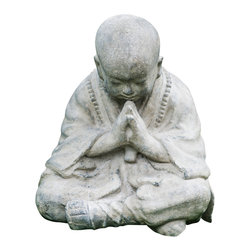 Repose Home - Invoking Monk - Welcoming all who enter your home or garden, this large statue of a young monk is depicted with traditional clothing and footwear wearing a beaded mala around his neck. Cast in elegant, stone washed volcanic ash and weatherproofed for indoor or outdoor use.
