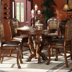 "Acme - 5-Piece Dresden Cherry Oak Finish Wood Round Counter Height Ped Dining Table Set - 5-Piece Dresden cherry oak finish wood round counter height pedestal dining table set with detailed carving. This set features a cherry oak finish wood round top dining table with hand carved detailing and leather like and fabric upholstered seat cushion on the chairs. This set includes the table and 4 chairs. Table measures 48"" Dia. x 36"" H. Stools measure 24"" H to the seat. Some assembly required."