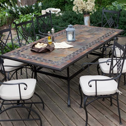 Belham Living - Belham Living Lucca 84 x 42 in. Mosaic Patio Dining Table Multicolor - ALH1391 - Shop for Tables from Hayneedle.com! Grand in design and seating capacity the Alfresco Home Lucca 84 x 42 in. Mosaic Patio Dining Table has room for eight and is loaded with exceptional details fine craftsmanship and the functionality for gracious entertaining. A combination of traditional Italian design and tasteful style this wrought iron and mosaic table speaks volumes on your discerning taste. A blend of warm earth tones will nicely accentuate any patio or deck. Natural slate and marble combine with hand-forged wrought iron to make the striking tabletop to this charming dining set. The hand-laid mosaic tabletop features a diamond-pattern trim around a simple square tiled center. Because these tiles are hand-set each Lucca table is truly one of a kind. A plugged umbrella hole means you're ready for shade any time. The mosaic tiles are hand-set and grouted with industrial adhesives for maximum durability. What this means is if the mosaic top gets wet the grout won't dry out and crack like traditional standard grout would. The top is then finished and sealed with an industrial-grade sealant called Fluorocarbon for superior protection. Natural wear and tear of elements may lead to blistering of the silicone top seal and natural aging of the tile materials. The hand-forged wrought-iron table frame is dipped in a zinc-phosphate bath and then electrostatically coated to help make a weather-resistant coating to delay the onset of rust. Following a quality check for strength and durability iron welds are ground for aesthetic appeal. Finally a powder-coated finish is applied and baked onto the iron for stronger color and protection. As fetching as it is functional this is a piece that will never go out of style. About Alfresco HomeOffering a wide selection of fashionable products from casual furniture and garden lighting to permanent botanicals and seasonal decor Alfresco Home casual living products offer a complete line of interior and exterior living furnishings and accents. Based out of King of Prussia Penn. Alfresco Home continues to blend indoor and outdoor furniture to make a lifestyle of alfresco living inside and outside of the home. Inlaid mosaic tabletops fine hardwood furnishings artisan-inspired accents premium silk botanicals and all-weather wicker sets are just a few examples of the kind of treasures you'll find in Alfresco's specially designed collections.
