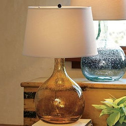 "CFL Eva Colored Glass Table Lamp, Amber - Subtle bubbles and striations provide beautiful evidence of our Eva Glass Table Lamp's handcraftsmanship. 15"" diameter, 24"" high Glass is hand blown. Includes an ivory cotton-linen drum shade. Title 20 compliant lamps will be shipped to CA addresses. {{link path='pages/popups/california_code_popup.html' class='popup' width='480' height='300'}}Learn more{{/link}} to understand product differences. Catalog / Internet Only."