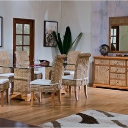 "Hospitality Rattan Sea Breeze Indoor 8 Piece 42 x 72 in. Seagrass Dining Set - N - Dinner for six or just a romantic dinner for two is just the kind of event that the Hospitality Rattan Sea Breeze Indoor 8 Piece 42 x 72 in. Seagrass Dining Set - Natural is designed to accommodate. The modern shape of this wide dining set starts with sturdy wooden frames on the chairs and pedestals. Natural, hand-woven seagrass creates the exterior of the pieces, with hardwood legs supporting the chairs and naturally finish solid hardwood creating the feet of the pedestals. A wide tabletop of tempered and beveled glass becomes the appealing surface that will become home to many meals and memories.Dimensions:Chair: 19W x 22D x 43H inchesTable: 72L x 42W x 31H inchesAbout Hospitality Rattan Hospitality Rattan has been a leading manufacturer and distributor of contract quality rattan, wicker, and bamboo furnishings since 2000. The company's product lines have become dominant in the Casual Rattan, Wicker, and Outdoor Markets because of their quality construction, variety, and attractive design. Designed for buyers who appreciate upscale furniture with a tropical feel, Hospitality Rattan offers a range of indoor and outdoor collections featuring all-aluminum frames woven with Viro or Rehau synthetic wicker fiber that will not fade or crack when subjected to the elements. Hospitality Rattan furniture is manufactured to hospitality specifications and quality standards, which exceed the standards for residential use. Hospitality Rattan's Environmental Commitment Hospitality Rattan is continually looking for ways to limit their impact on the environment and is always trying to use the most environmentally friendly manufacturing techniques and materials possible. The company manufactures the highest quality furniture following sound and responsible environmental policies, with minimal impact on natural resources. Hospitality Rattan is also committed to achieving environmental best practices throughout its activity whenever this is practical and takes responsibility for the development and implementation of environmental best practices throughout all operations. Hospitality Rattan maintains a policy of continuous environmental improvement and therefore is a continuing work in progress. Hospitality Rattan's Environmentally Friendly Manufacturing Process All of Hospitality Rattan products are green. From its basic raw materials of rattan poles, peels, leather, bamboo, abaca, lampacanay, wood, leather strips, and boards, down to other materials like nails, staples, water-based adhesives, finishes, stains, glazes and packing materials, all have minimum impact to the environment and are safe, biodegradable, recycled, and mostly recyclable. Aside from this, the products have undergone an environmentally-friendly process that makes them """"greener."""" The company's rattan components are sourced from sustained-yield managed forests, which means the methods used to grow and harvest the rattan vines ensure the long-term life of the forest and protect the biodiversity of the forest's ecosystems. Hospitality Rattan is committed to buying and using all materials, from rattan and hardwood to finishing materials, from reputable and renewable suppliers and seeks appropriate evidence that suppliers are in compliance with this policy. Hospitality Rattan strives to use materials that are processed in an environmentally responsible manner, or consist of a high level of recycled material. Finishing materials and stains used in Hospitality Rattan's furniture products consist of 75% water-based solutions which evaporate upon application with reduced or Volatile Organic Compounds (VOCs). The furniture factories use water-based glues, stains, topcoats and other finishes on all of their products. The switch from traditional solvent-based processes to water-based processes involved consolidating several processes by the factories, resulting in an 85% reduction in VOC emissions."
