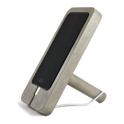 Recycled Stone Dust iPhone Docking Station - This unique iPhone dock is handcrafted in the USA from a proprietary blend of cement and recycled stone dust, which a byproduct of the countertop industry. The dock is designed to stand vertically or horizontally, and has a removable concrete peg that fits right into the back in order to stand it upright. Help create a sustainable world and dock your iPhone securely and industrially on this unconventional creation of modern design.