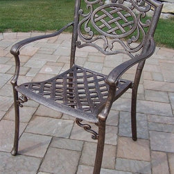 Oakland Living - Outdoor Stackable Chair - Set of 4 - Set of 4. Metal hardware. Fade, chip and crack resistant. Traditional lattice pattern and scroll work. Handcasted. Lightweight. Hardened powder coat. Warranty: One year limited. Made from rust free cast aluminum. Antique bronze finish. Minimal assembly required. 23 in. W x 22 in. D x 35.5 in. H (25 lbs.). Overall weight: 100 lbs.This arm chair will be a beautiful addition to your patio, balcony or outdoor entertainment area. Our arm chairs are perfect for any small space, or to accent a larger space. We recommend that the products be covered to protect them when not in use. To preserve the beauty and finish of the metal products, we recommend applying an epoxy clear coat once a year. However, because of the nature of iron it will eventually rust when exposed to the elements. The Oakland Mississippi Collection combines southern style and modern designs giving you a rich addition to any outdoor setting.