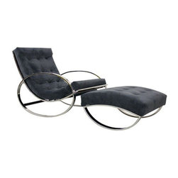 Used Mid-Century Italian Chrome Rocking Chair & Ottoman - This classic Mid-Century chrome Italian rocking chair with a corresponding ottoman by Renato Zevi and imported by Selig is sure to rock your world. The chair features circular arms, a subtly curved back, and has been professionally reupholstered in a soft, slightly textured dark steel blue (that can appear grayish when next to a true blue) fabric. This is the perfect lounge chair and ottoman set for a living room or the coolest nursery in the entire world.     The chrome frame is in excellent condition overall with one small area of scratches on one of the arms, which are barely noticeable.      *Two other single chairs without ottomans also available in other listings.  See the last image below.
