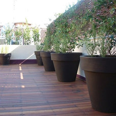 Modern Outdoor Planters by Surrounding - Modern Lighting & Furniture