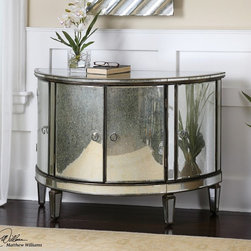 Sainsbury 4 Door Mirrored Chest - Glamorous, vintage and functional in design. Demilune shape given a fresh face of curved mirrors around the antique bronze, solid birch wood frame. Four cabinet doors are accented with chrome ring pulls.