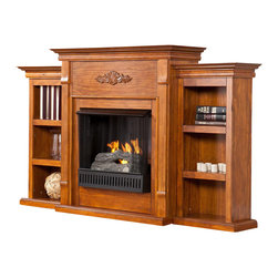 Holly & Martin - Fredricksburg Gel Fireplace with Bookcases - Includes Firebox, cement log, faux coal cinder, and screen kit. Features 6 shelves. Provides storage and functionality, perfect for any room. Beautiful media room accent. Max weight capacity: 85lbs (mantel). Accommodates up to a 42 in. flat panel TV. Constructed of pine, MDF, and pine veneer. None of the mess of a wood burning fireplace. FireGlo Gel Fuel Snaps and Crackles like real wood (fuel not included). Emits no smoke, odor, or ash. Holds up to 3 cans of gel fuel simultaneously for a full bodied 6-8 in. flame. Each can of FireGlo produces up to 3000 BTU. Supplements heat to save on energy consumption. Glazed pine finish. Assembly required. 70.25 in. W x 14 in. D x 42.25 in. H. Shelves: 12 in. W x 7.5 in. D x 8.5 in. H If you are looking for an elegant accessory for your home, this is the piece for you. This beautiful and functional gel fuel fireplace features a glazed pine finish that looks great in any room. A classic floral design is carved across the top of this fireplace, above the firebox. Three bookcase shelves on either side of the firebox provide space and storage for all of your favorite readings, media and home decor accessories. Requiring no electrician or contractor for installation allows instant remodeling without the usual mess or expense. In addition to your living room or bedroom, try placing this fireplace in your home office. Use this great functional fireplace to make your home a more welcoming environment.