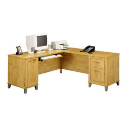 Bush - L Desk w File Drawers and Box Drawer - Finished in a light maple color, this solid wooden L-shaped desk is stylish without forsaking function.  This desk includes rear holes for computer connections as well as spacious desktops to finish multiple projects before deadlines are up.  Those who buy this desk will be pleasantly surprised by its large amount of storage space, including two box drawers and a legal and letter sized file drawer. * File drawer for letter & legal-size files. Box drawer for office supplies. Keyboard and pedestals may be mounted on the right or left side . Rear-wire hook up promotes easier accessibility. Hidden CPU storage area. Accepts Hutch WC81711. Maple Cross finish. 70.984 in. W x 70.984 in. D x 29.031 in. H