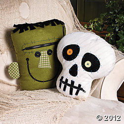 """Zipper Mouth Character Pillows - These are fun throw pillows that will give your favorite chair a little """"spook"""" factor. For the price, you definitely can't pass up this opportunity to decorate your home for Halloween. I like that they look handmade, too."""