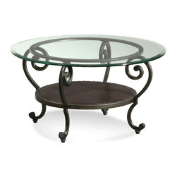 Bassett Mirror - Dauphine Round Cocktail Table - Whimsical curls bring elegant grace to this gunmetal-finish cocktail table. A bottom storage shelf is covered in luxurious leather, and the entire table is topped with a panel of gleaming glass.
