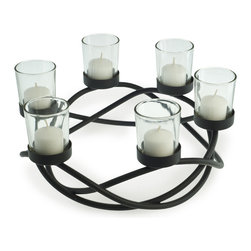 Danya B. - Round Waves Candleholder - Add rustic illumination to your table when you use this unique, round candleholder as a stunning centerpiece. It's crafted from wrought iron with a black finish, and will hold six candles in its clear votive glasses.