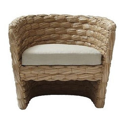 """Chunky Weave Chair - This curvy chair adds a whole lot of texture and shape to a furniture layout; the natural woven seagrass gives off a coastal and Mediterranean vibe; the rounded shape makes it modern.Dimensions: 34.5""""w x 28.5""""d x 29.75""""h. Woven seagrass with lacquered finish. • 55% linen/45% cotton natural-colored cushion with polyurethane foam (included)."""