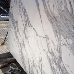 Italian calacatta gold marble slabs from Royal Stone & Tile in Los Angeles - Calacatta Gold Borghini is quarried from a bedrock quarry in the Apuan Mountain range next to Carrara, Italy where several different quarries