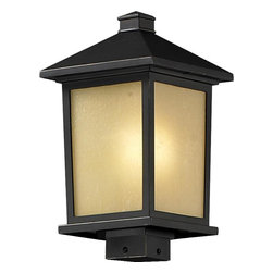 One Light Oil Rubbed Bronze Tinted Seedy Glass Post Light - Clean, mission styling and rectangular detailing define the classic styling of this large outdoor post head. Tinted seedy glass panels create an elegant glow, while the cast aluminum hardware finished in oil rubbed bronze can withstand nature's seasonal elements.