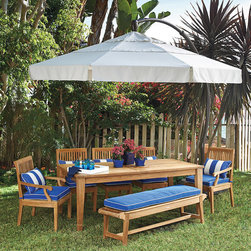 "Frontgate - 11' Round Side Mount Patio Umbrella - 11' dia. cantilever design provides 100 sq. ft. of shade at virtually any angle. Lightweight yet sturdy powdercoat-finished, 2-3/4"" dia. aluminum pole. One-handed crank operation glides the umbrella up and into a horizontal or angled position. Double-vented, marine-grade canopy is made of 100% solution-dyed polyester to resist the damaging effects of sun, mildew, and dirt. Canopy is machine washable; air dry only. From dawn to dusk, the Side-mount Umbrella blocks the sun's glare as it moves across the sky, virtually shading you from all angles of the sun. This resort-quality, cantilever umbrella easily tilts and pivots 360&#176 around the base, requiring no maintenance. . . . . . Spot clean canopy with warm water (no higher than 100 degreesF) and a mild natural soap; rinse thoroughly to remove soap and air dry. Base lends solid, wind-defying support when filled with water and sand (water and sand not included). Basic umbrella cover included, or add an optional full cover that protects the umbrella and base . View simple set-up instructions for this umbrella. Always close umbrella when not in use, or in inclement weather."