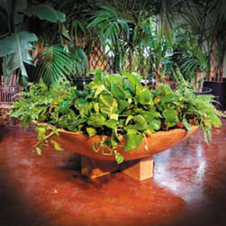 Cross Wok Garden Planter - I love how this planter is low slung to the ground. The idea of using a wok design is ingenious. It's a great way to add different elements at different heights.