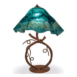 Mathews & Company - Wrought Iron San Saba Table Lamp with Large Glass Shade - Our Rustic style wrought iron San Saba Table Lamp with Large Glass Shade is a beautiful piece of hand-crafted home furniture. Lamp is UL Approved and pre-wired, all you have to do is add a light bulb and plug it in to start enjoying its warm light. Pictured in Turquoise shade and Aged Rust finish.