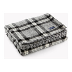 "Faribault Woolen Mill Co. - Soho Plaid Wool Throw, Black/Gray Plaid - With the mill on the cusp of going out of business in 2008, a mill designer was directed to create a salable throw using remnant yarns salvaged from the mill's dwindling inventory. The result became the SoHo (short for ""stuff on hand only"" - with a nod to our favorite part of Manhattan). We resurrected that design as we revived the mill and today it's become one of our most popular items. Born out of necessity, the SoHo lends a luxurious and sophisticated look to any room. 100% pure wool and finished with a whip-stitch edge. Permanently moth-proofed."