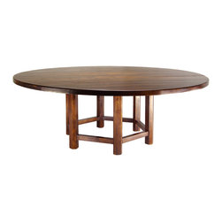 Patagonia Legacy - Base Equis Dining Table DS916 - The base of this table is a study in sixes. Each one of our six table legs is hand carved into a hexagon and linked to its fellows with a stretcher. That makes the base vaguely circular. We topped our new base with a simple, round table top. Shown here in our Miel Antique hand-rubbed finish.