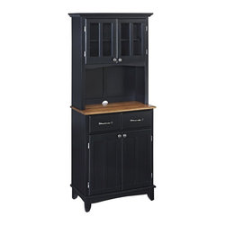 HomeStyles - Buffet and Hutch in Black Finish - The soft gleam of black makes this buffet a standout choice for any space. Matching hutch adds a traditional and stately appearance with upper shelving that will tuck collectibles neatly behind Plexiglas doors. Cabinet top features a cottage oak finish. * Buffet top in cottage oak finish. Buffet with two doors. Adjustable shelf and two utility drawers suspended on metal drawer slides. Hutch with two wood framed cabinet doors. Plexiglass doors with an adjustable shelf inside for plenty of storage. Cabinet equipped with adjustable floor levelers. Brushed steel hardware. Clear coat finish to help protect against wear and tear from normal use. Made from Asian hardwood and wood products. Made in Thailand. Assembly required. Buffet: 29.25 in. W x 15.87 in. D x 36 in. H. Hutch: 31.25 in. W x 15.87 in. D x 71.5 in. HThis buffet and hutch set is designed to provide added storage and workspace for the kitchen and dining areas of the home.
