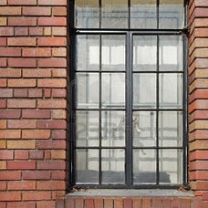 Multi-shade Red Brick Wall With Black Metal Bordered Glass Windows Royalty Free