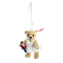 Clara the Nutcracker Teddy Bear Ornament EAN 682353 - The ballet has become a holiday tradition, as Clara has danced her way into our hearts. Now she can adorn your Christmas Tree in the form of this very special ornament - exclusively from Steiff! A petite blond mohair Teddy wear's a lace tutu that's trimmed with a silk bow. In her hand, she holds the tiniest real wooden nutcracker we've ever seen! All handcrafted in Germany with you in mind.