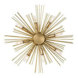 Jiten Sconce - This starburst design in antique brass has eight lights and works as well on the wall as it does as a ceiling mount. Shown with small clear tubular bulbs.