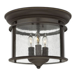 Hinkley Lighting - Gentry 3-Light Flush Foyer - Gentry's traditional design is offered in three classic finishes, Olde Bronze, Pewter and Polished Brass. The clear bent glass panels, white candle sleeves and coordinating candle chasers add classic elegance to this timeless style.