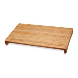 Lipper International Inc. - Over The Sink/Stove Large Bamboo Cutting Board - Prepare a feast tonight with this large bamboo over-the-sink cutting board. This generously sized cutting board lets you cut and dice large quantities of vegetables or meats and its special design will hold the board in place while you prepare your meal.