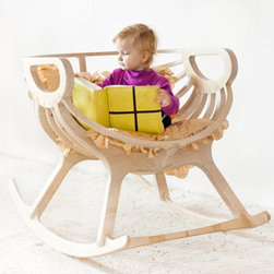 Rocking Chair by TreeSky - Like a carefully assembled puzzle, here is a rocker with lots of added details. The ribbing is like a cradle - in fact, you can also order a dollhouse-size version of the chair for your little ones.