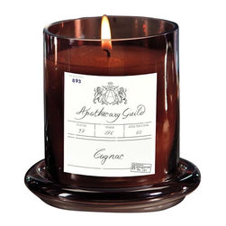 Apothecary Guild Scented Candle with Glass Dome - Cognac - A delightful vessel that is reminiscent of old world apothecary jars from Europe is combined with a sweet Thistle aroma that is both light and inviting. The candle is topped with a glass dome that adds an element of interest and loveliness to the piece.