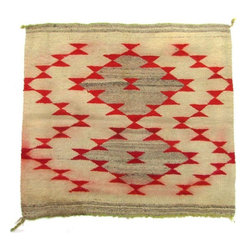 """Pre-owned Antique Navajo Bowtie Mat - An early 20th century Navajo textile mat in the Gallup throw-style, with red and grey bowtie decorations on a cream background with lime green selvedge. It is stamped in the corner """"188599"""" on one side. There is one stable hole and the red dye has bled in places as pictured. It would make a great tabletop textile or could easily be sewn into a large throw pillow."""