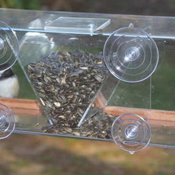 Songbird Essentials - Window Feeder 8 - WF 8 window feeder holds 4 cups of seed in its center hopper. Room at each side for birds to feed. Has a top pivoting cover over the V shaped hopper for ease of filling the feeder. Holds 4 cups.