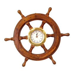 Handcrafted Nautical Decor - Ship Wheel Clock 18'' - The Hampton Nautical Deluxe Class Wooden Ship's Wheel is by far the highest quality ship wheel available.  Our   Deluxe Class solid wood ship wheels have  distinct and clearly visable   wood grain.  In addition, they are  hand-sanded with additional coats  of  lacquer which give this decorative  ship wheel a slight gloss which   makes this a perfect nautical decor accent  for your home, boat or   office.    --Made from rare, high quality Shisham   wood which is hard, strong and is highly regarded for its ability to   resist the elements.  The decorative wooden ship wheel has six spokes,   each skillfully turned and assembled with plugged screw heads. The brass   center hubs have uniform sizes holes and machined keyways.  --In addition, the center of the wheel   is solid brass and includes a real, working clock. The clock is   approximately 7-inches in diameter and rests perfectly inside the ship   wheel.--This small wooden ship wheel clock   requires AA batteries to operate (not included) which can be easily   installed in the back. This ship wheel clock also features a hinge on   the back, making it very easy to hang on any wall.--NOTE:  This wooden ship wheel is for decor purposes only and is not indented for use on a seafaring vessel.--Dimensions: 18'' x 2'' x 18''-- ----    Highest quality wooden ship wheel available--    Handcrafted from exotic solid Shisham wood with a brass center--    Distict and clearly visable wood grain--    Hand-sanded with extra coats of laquer for a slight gloss--    Weather resistant - indoor and outdoor use--    Heavy, sturdy and durable - weighs over 6 pounds----