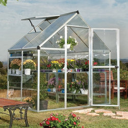 Palram - Palram Nature Hybrid Greenhouse - HG5504 - Shop for Greenhouses from Hayneedle.com! Flowers fresh produce green herbs they're all natural inhabitants of the Palram Nature Hybrid Greenhouse a small-scale greenhouse designed for compact spaces. Available in several sizes and finishes this greenhouse boasts a rust-resistant aluminum frame and advanced polycarbonate panels made from only virgin materials that won't become brittle or turn colors over time. Virtually unbreakable polycarbonate won't shatter the way glass can. This reliable crystal-clear material safely provides 90% light transmission to plant life inside and 4mm twin wall roof panels block up to 99.9% of harmful solar UV radiation.Additional features include a lockable door handle integrated rain gutters (collect the rain water runoff for sustainable irrigation) and a roof vent and magnetic door to keep oxygen flowing and lower the internal temperature on warm days. Assembly is easy thanks to a smart panel slide and lock system that requires no special tools. Includes manufacturer's five-year limited warranty. Snow load: 35 lbs. per square foot.Dimensions6 x 4 feet: 48L x 72W x 84H in.6 x 8 feet: 96L x 72W x 84H in.Door dimensions: 22.2W x 64.2H in.Peak height: 82.2 in.Sidewall height: 48.8 in.Growing space: 26.5 square feetAbout Palram Industries LTD.Over 45 years of experience makes Palram one of the world s largest and most advanced manufacturers of polycarbonate PVC Acrylic and other thermoplastic sheets for a variety of industries including construction graphics and display architecture and for the do-it-yourself market (DIY). The company has manufacturing facilities in Israel USA England Germany China and Russia. Palram integrates high quality materials a spectrum of technologies and diligent novelties state-of-mind to manufacture valuable products for do-it-yourselfers.