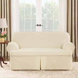 Sure Fit - Sure Fit Cotton Duck T-Cushion Sofa Cover - 40812 - Shop for Chair and Slip Covers from Hayneedle.com! About Sure FitSurefit Inc. is widely known for its attractive quality furniture covers slipcovers and decorative accessories. The success of their ready-made furniture slipcovers and accessories is based on extensive experience providing cost-effective decorative solutions made to fit in a broad range of styles to meet the needs of all customers. Sure Fit's furniture slipcover product line includes slipcovers for sofas loveseats chairs oversized chairs wing chairs dining room chairs recliners ottomans and folding chairs as well as furniture and pet throws. Sure Fit also sells coordinating decorative pillows.Sure Fit is dedicated to quality with rigorous durability and performance standards that are second to none. Many patterns feature dual-action Scotchgard Protector to repel and release stains. Home of the Ten Minute Makeover Sure Fit provides an attractive and affordable solution for consumers who need to protect furniture from children pets and general wear or want to quickly and cost-effectively upgrade their furniture and enhance the appearance of any room.Please note this product does not ship to Pennsylvania.