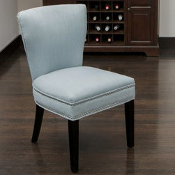 Jackie Ocean Blue Fabric Accent Dining Chair - Bring out your personal style with the Jackie Ocean Blue Fabric Accent Dining Chair and its elegant nailhead accents. Finished in ocean blue, this chair is upholstered in a durable fabric. Its contemporary style is complete with its rich brown wood legs holding it all together.About Best Selling Home Decor Furniture LLCBest Selling Home Decor Furniture LLC is a US-based company dedicated to providing you with a wide variety of fine furniture. With sales and manufacturing offices in Europe and China, as well as the ability to ship to anywhere in the world, no one is excluded from bringing these lovely pieces home. From outdoor to indoor furniture, children's furniture to ottomans and home accessories, all your needs will be met with attractive, high quality products that will last.