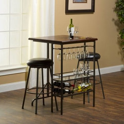 Hillsdale Bardstown Bar Table Set with 2 Stools - A table and serving station all in one the Hillsdale Bardstown Bar Table Set with 2 Stools makes a great addition to any home. The table and stools have sturdy metal frames finished in pewter with black vinyl upholstery on the stools. A glass rack with an 8-glass capacity a storage shelf for additional glassware and an 8-bottle wine rack make this table an indispensable tool for entertaining your guests. Dimensions: Table: 30W x 30D x 42H inches Stools: 22W x 22D x 30H inches About Hillsdale FurnitureLocated in Louisville Ky. Hillsdale Furniture is a leader in top-quality affordable bedroom furniture. Since 1994 Hillsdale has combined the talents of nationally recognized designers and globally accredited factories to bring you furniture styling and design from around the globe. Hillsdale combines the best in finishes materials and designs to bring both beauty and value with every piece. The combination of top-quality metal wood stone and leather has given Hillsdale the reputation for leading-edge styling and concepts.