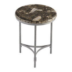 HomeStyles - Turn to Stone Accent Table - I'm Petrified.  Generate interest in your home with this conversation piece. Created from petrified wood, the Home Styles' Turn to Stone Console Table has been repurposed for your one of a kind side table. The natural radiant elements applied to a transitional home decor appeal, this table is inimitable. This made-by-nature piece is constructed of powder-coated metal frame and petrified wood. Each table is unique, there are no two alike, and this can be seen through the different techniques taken to achieve such an exquisite table. The exposed wood is inlayed in resin with a polished top coat. The metal frame's hammered look finish completes the appearance of this earthy piece. 17 in. W x 17 in. D x 20 in. H