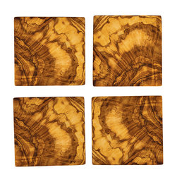 Olive Wood Set of 4 Square Coasters - The Olive Wood Set of 4 Square Coasters are fabricated from olive wood harvested from older trees that no longer produce olives, making it a sustainable material. Each coaster boasts a warm, rich color and its own unique grain pattern that adds to the rustic yet refined beauty of the piece. Owing to the nature of the wood, variations in the wood grain are to be expected.