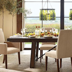 """Benchwright Dining Table & everydaysuede(TM) Chair Set - Inspired by the spirited, industrial character of an early 20th-century work table, the Benchwright Dining Set provides a bold backdrop for creative entertaining.Dining Table: 86"""" long x 42"""" wide x 30"""" high; extends to 122"""" long; seats up to 12.Buffet: 66"""" wide x 19"""" deep x 36"""" highBar & Hutch: 42"""" wide x 18"""" deep x 58"""" highGrayson Leather Side Chair: 19"""" wide x 23"""" deep x 39"""" highGrayson Leather Armchair: 23.5"""" wide x 25"""" deep x 39"""" highExpertly crafted from thick planks of meticulously weathered and distressed hardwood with forged iron.Accented with grooves and saw marks to create the look of salvaged lumber.Detailed with oversized bolts on the legs and tabletop.Chairs are upholstered in the finest-quality top-grain or bicast leather.Buffet is fitted with 2 paneled-door cabinets, each with 2 adjustable shelves and 3 drawers.Bar & Hutch is fitted with a gallery shelf that holds glassware and bottles, offering generous storage in a compact form.Wood swatches, below, are available for $25 each. We will provide a merchandise refund for wood swatches if they're returned within 30 days."""