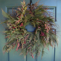 Rustic Wreath by HomeHearthGarden - An array of faux cedar leaves 'needles' mixed with artificial berries and leaves on a wispy wreath base.